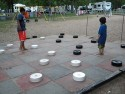 Youngsters playing checkers on a life sized checker board
