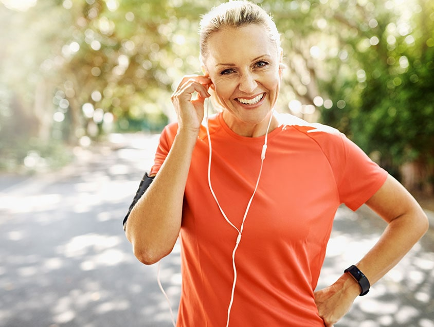 active woman listening to headphones