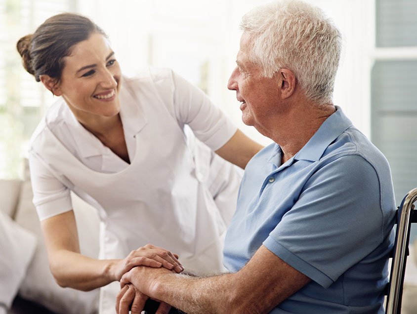 caregiver assisting older man