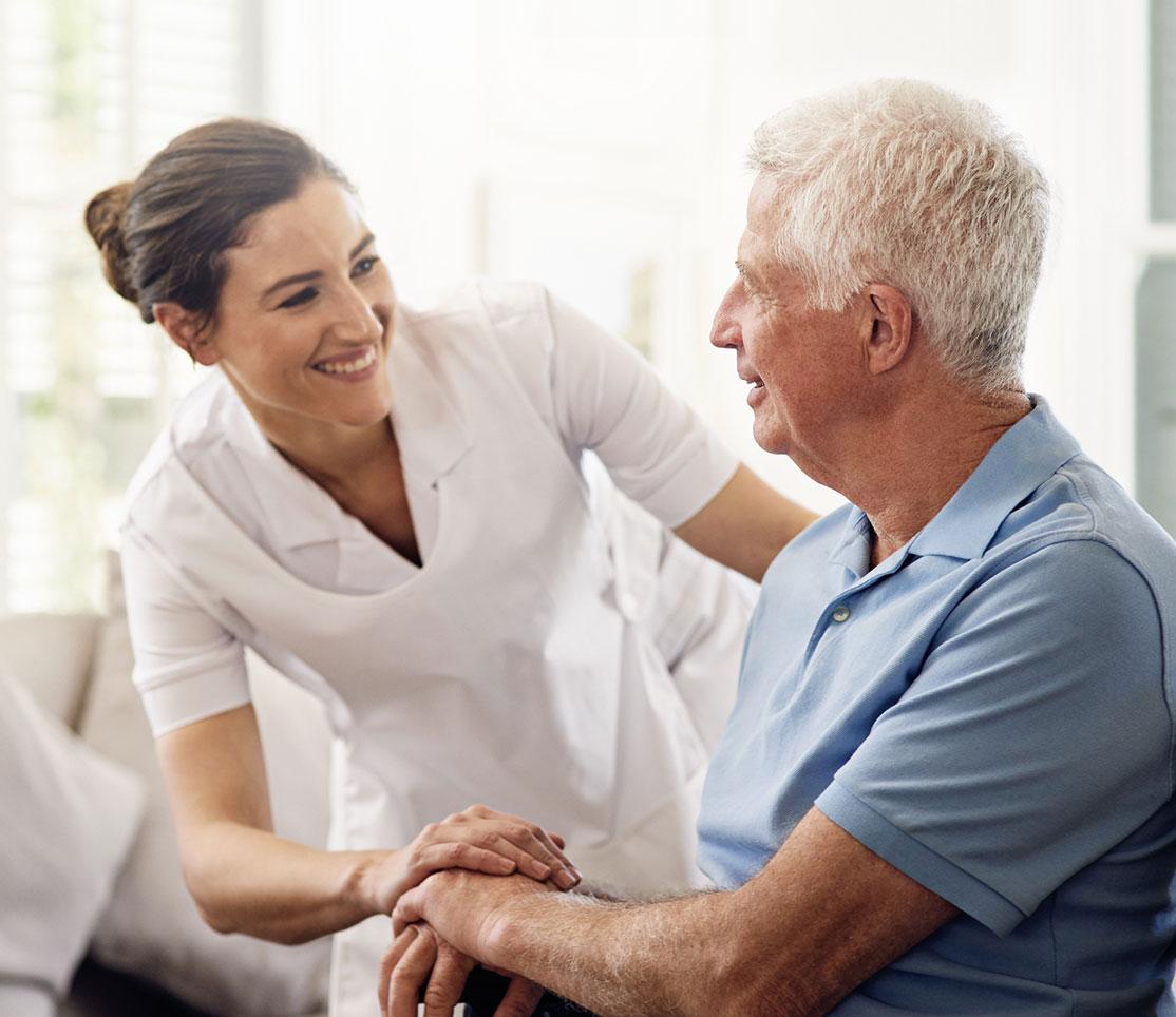 certified nurse helping male patient