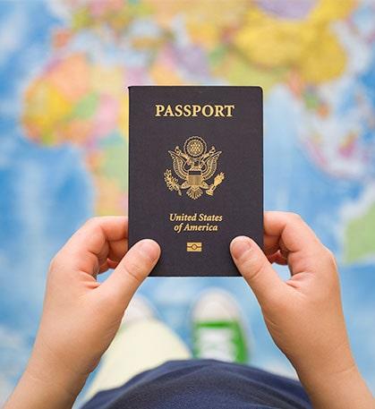child holding passport