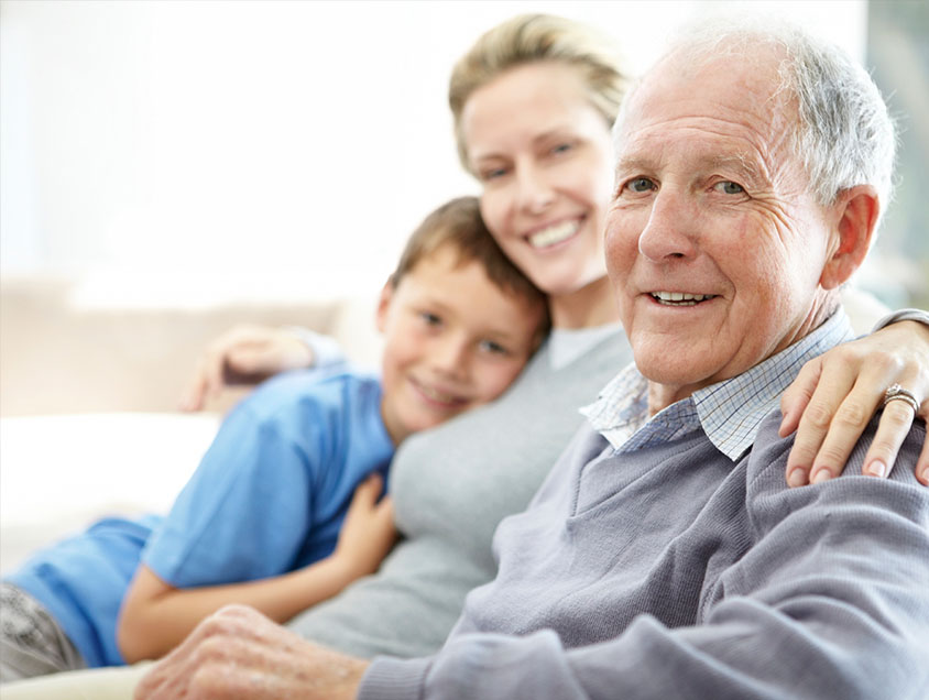 family visiting elderly man