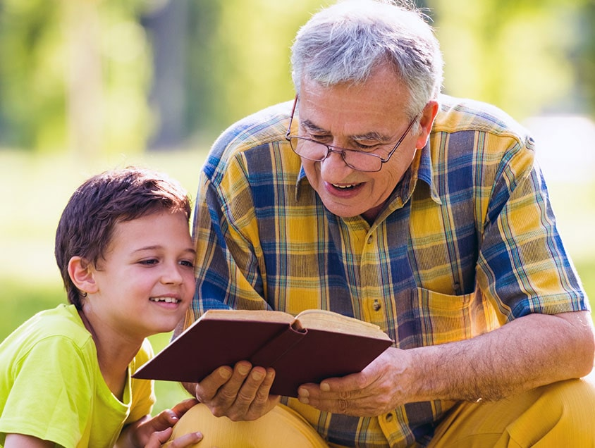 grandparent reading to child