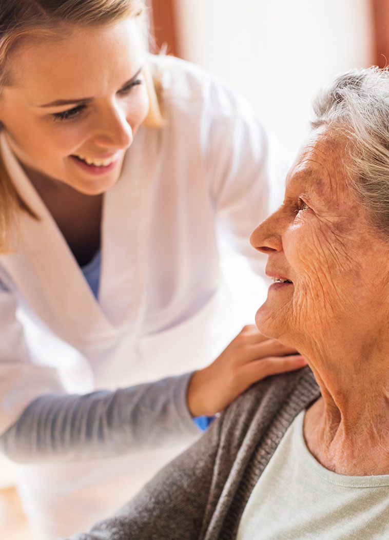 helping an elderly woman