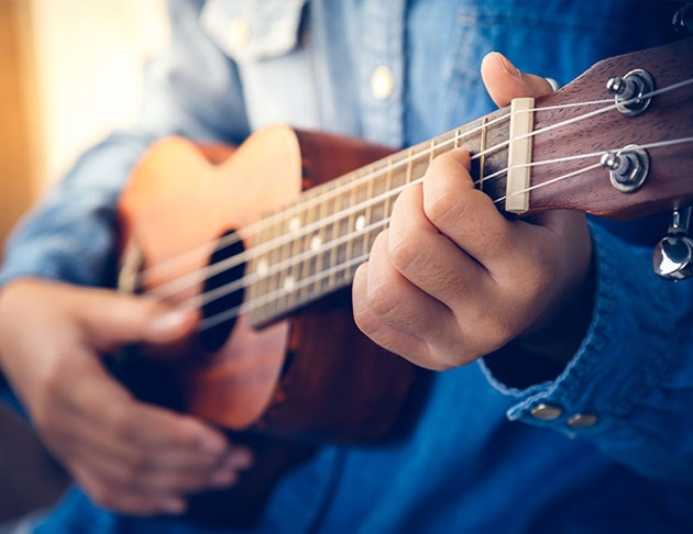 musician playing ukulele