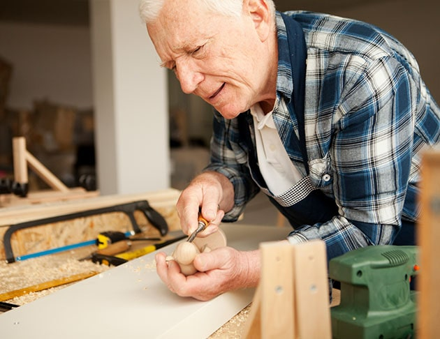 older man wood working