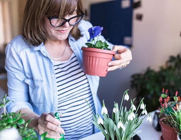woman holding flower pot