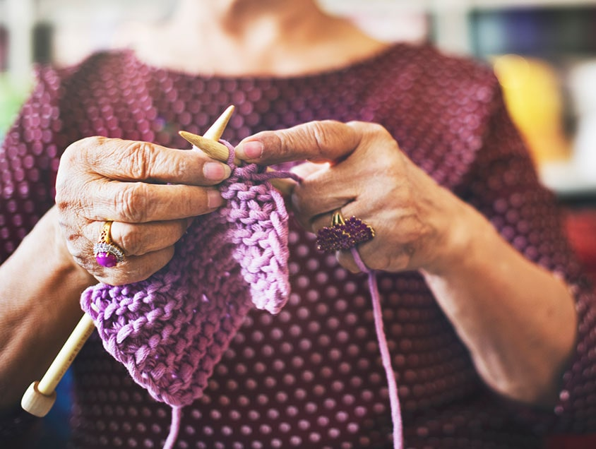 Woman knitting scarf