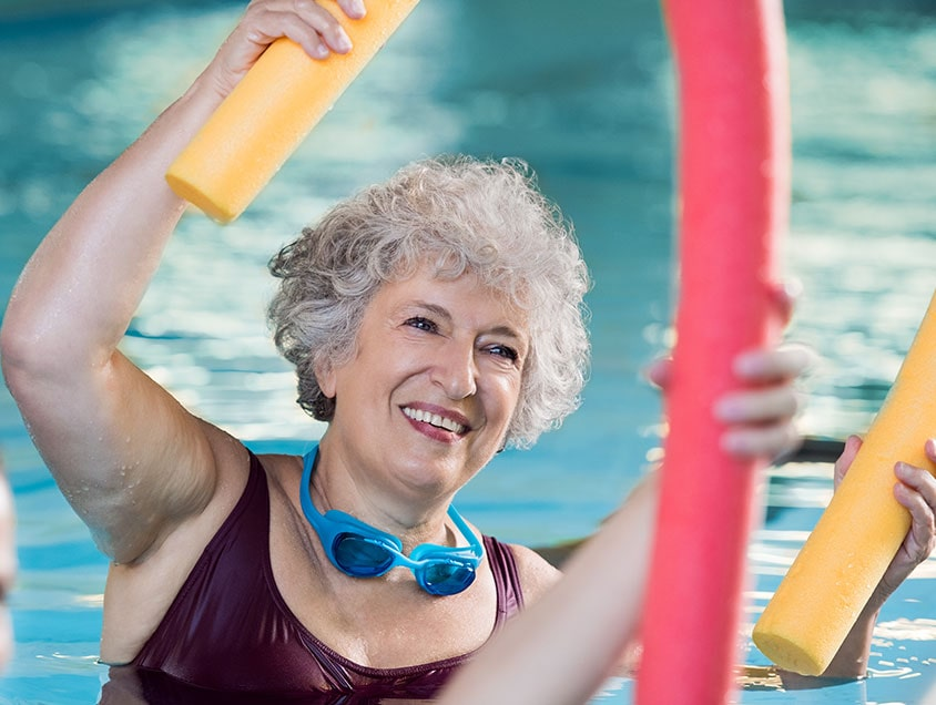 woman participating in water aerobics