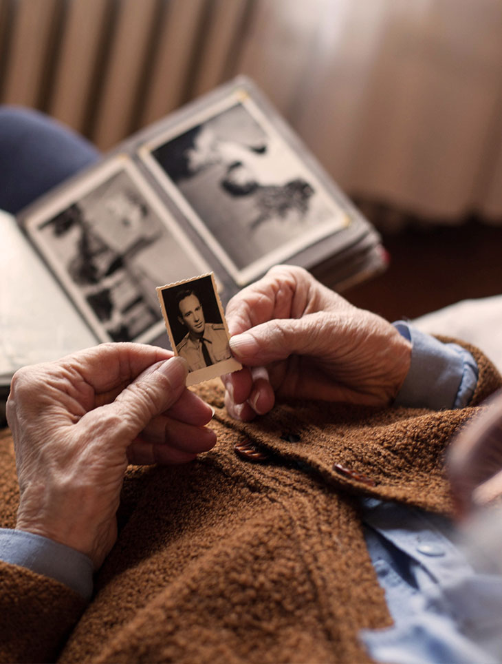 older woman looking at memories