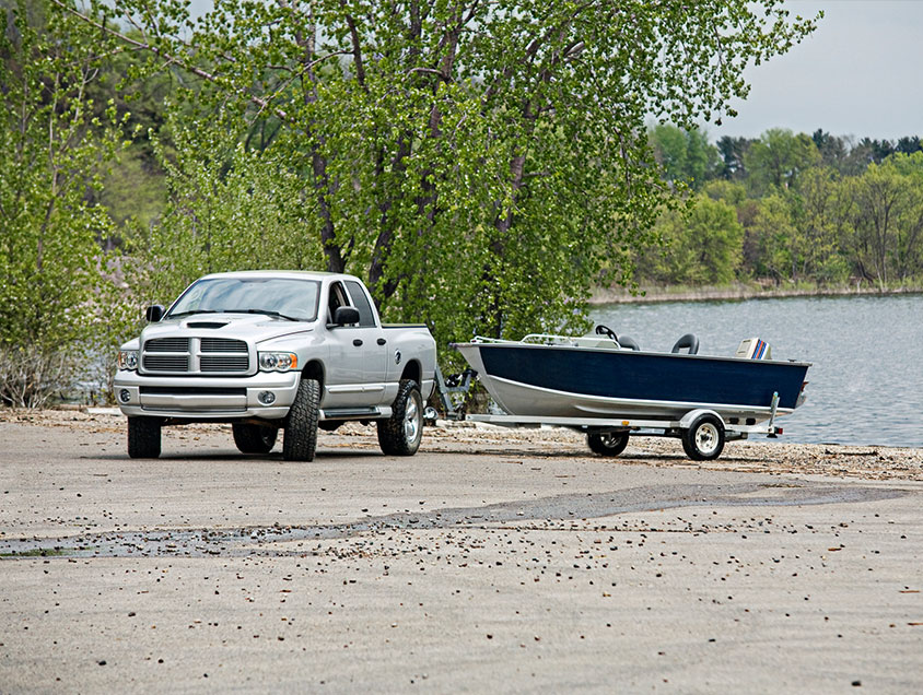 truck and boat at boat launch