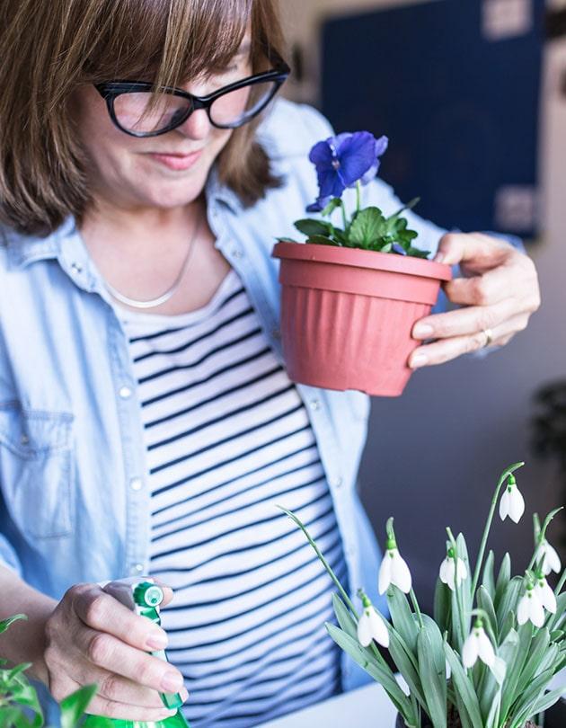 woman holding flowerpot