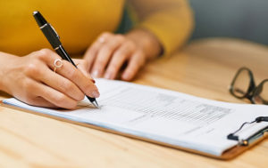 woman filling out form
