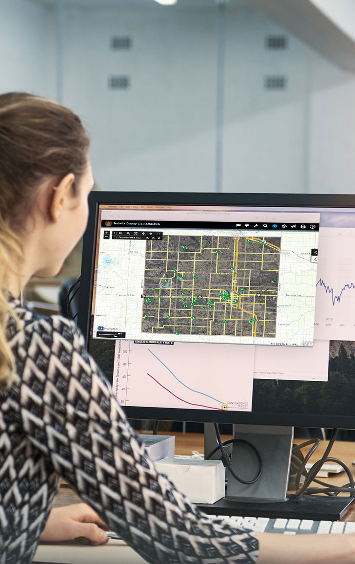 woman looking at map on computer